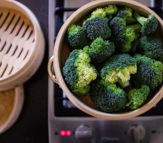 broccoli in a bamboo steamer